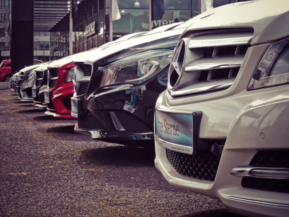 Luxury cars parked in a row